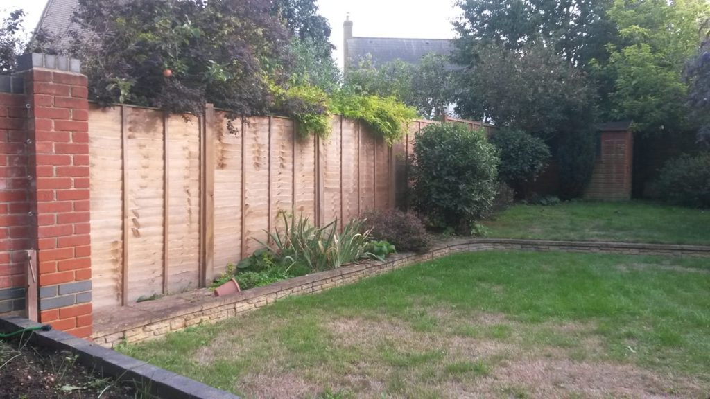 Lap Panel Fencing with Wooden Posts